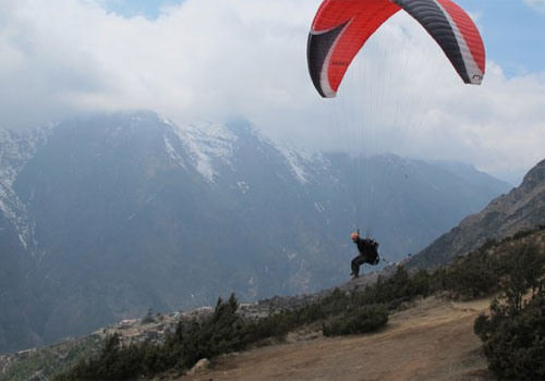 Babu flies from above Namche Bazaar on the walk in. Photo: Babu Sunuwar
