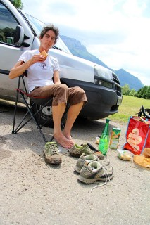 Charlie eating lunch and changing shoes before the next section of the hike