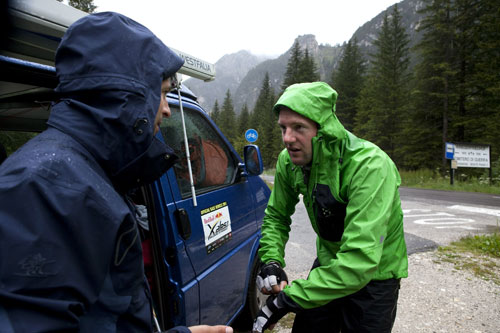 Weather for ducks ... Chrigel Maurer meets his supporter in Landro, Italy, today, 20 July 2011. Photo: Red Bull X-Alps