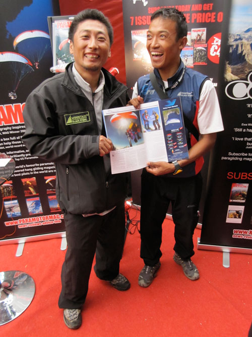 Babu (R) and Lakpa, Everest pilots, check out their photos in Cross Country mag