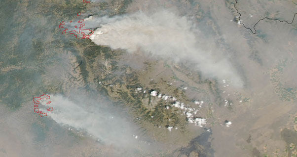 Smoke streams east from wildfires in Idaho, photographed by NASA on 14 August