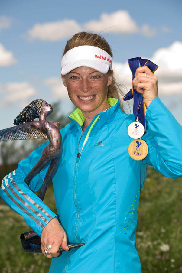 Corinna with medals and a trophy from the Monte Cucco World Championships, 2011