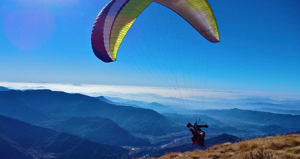 Mitch Riley paraglides in Nepal