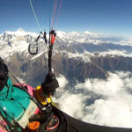 Herve Burdet paraglides over Machapuchare in Nepal