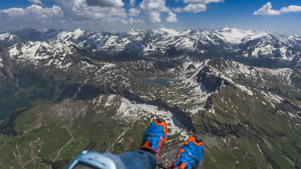 Mountain Paragliding by Andy Busslinger