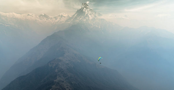Cody Tuttle paragliding in front of Machapuchare, Nepal