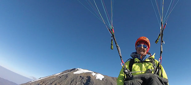 Charlie King paraglides from Kilimanjaro